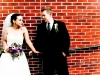 brick-wall-bride-groom